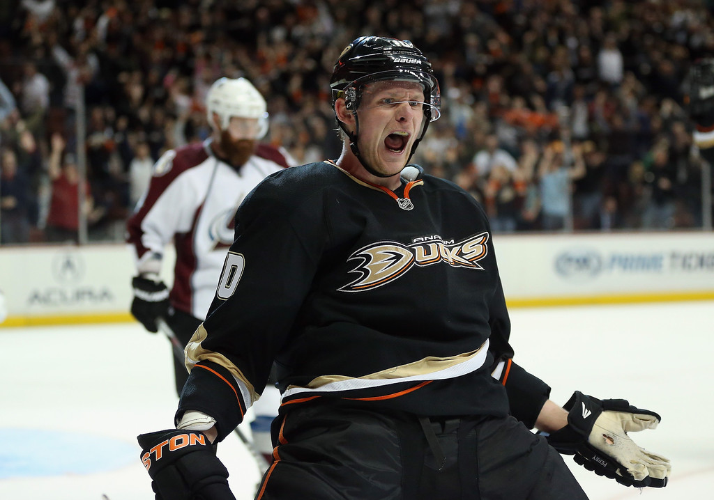 . Corey Perry #10 of the Anaheim Ducks celebrates after scoring the game winning goal in overtime against the Colorado Avalanche at Honda Center on February 24, 2013 in Anaheim, California. The Ducks defeated the Avalanche 4-3 in overtime.  (Photo by Jeff Gross/Getty Images)