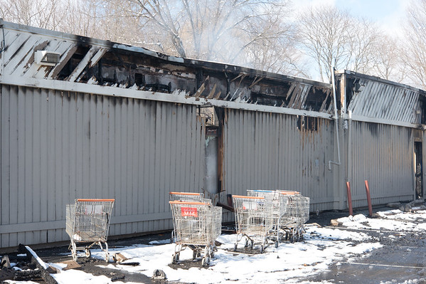 03/04/19 Wesley Bunnell | Staff Fire destroyed Tops Marketplace located at 887 Meriden-Waterbury Tpke in Southington on Monday night. Shopping carts line one side of the burned out building.