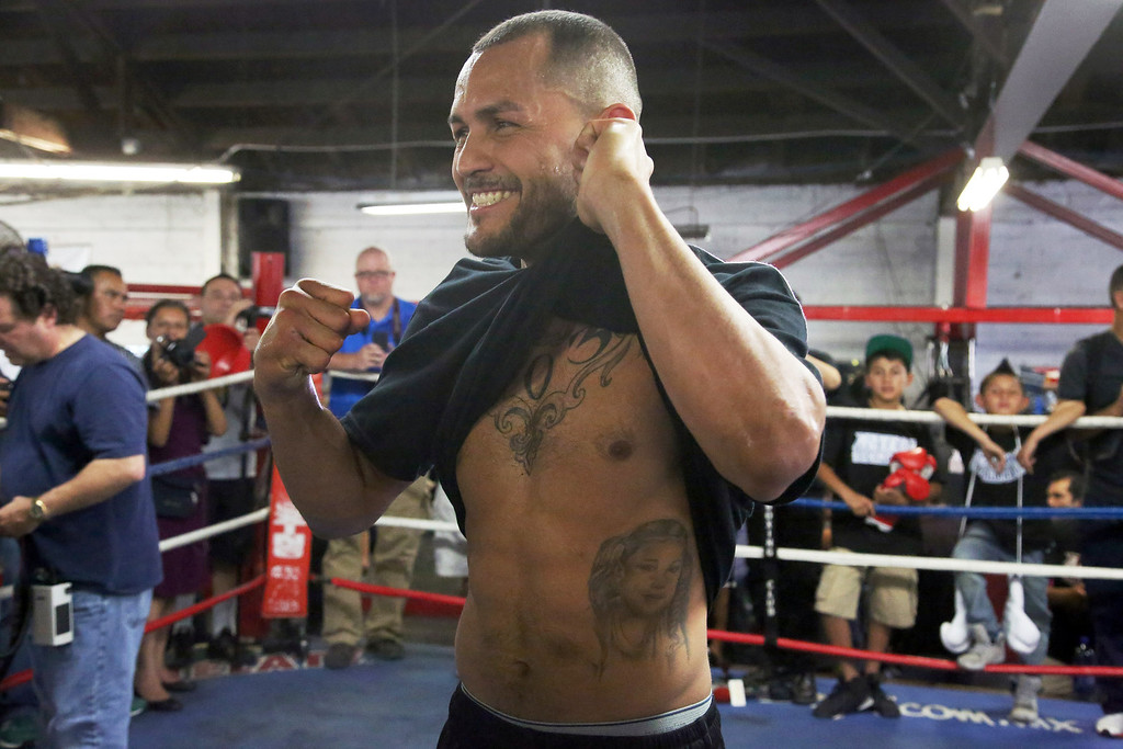 . Mike Alvarado poses in the ring during a workout in front of the media in Bell, Calif., Wednesday, May 14, 2014. He and Juan Manuel Marquez, of Mexico, are preparing for their WBO welterweight elimination bout at the Forum in Inglewood, Calif., Saturday. The winner will become the mandatory challenger to WBO welterweight champion Manny Pacquiao. (AP Photo/Nick Ut)