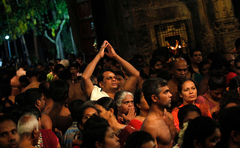 . A Hindu devotee prays during the annual Maha Shivaratri festival at Shivam Kovil in Colombo on March 10, 2013. Sri Lanka\'s Hindu devotees celebrate the annual Maha Shivaratri festival by fasting for an entire day and holding a night long vigil at Hindu temples island wide. REUTERS/Dinuka Liyanawatte