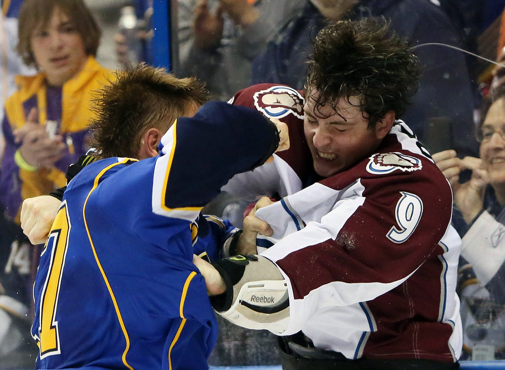 . St. Louis Blues left wing Vladimir Sobotka, left, fights with Colorado Avalanche center Matt Duchene during the second period of an NHL hockey game, Thursday, Nov. 14, 2013, in St. Louis. (AP Photo/St. Louis Post-Dispatch, Chris Lee)