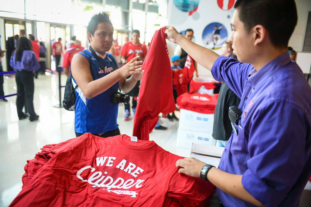 . Fans get Clipper shirts at a rally at Staples Center Monday August 18, 2014.  ( Photo by David Crane/Los Angeles Daily News )