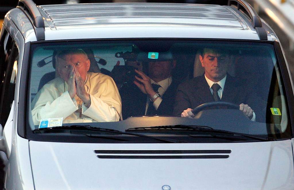 . Pope John Paul II leaves Rome\'s Gemelli Polyclinic hospital where he was hospitalized, Sunday, March 13, 2005. The pope left the hospital weeks after  suffering another breathing crisis and hours after greeting pilgrims in a voice  that was raspy but raised hopes among Roman Catholics that he would recover. (AP Photo/Andrew Medichini)