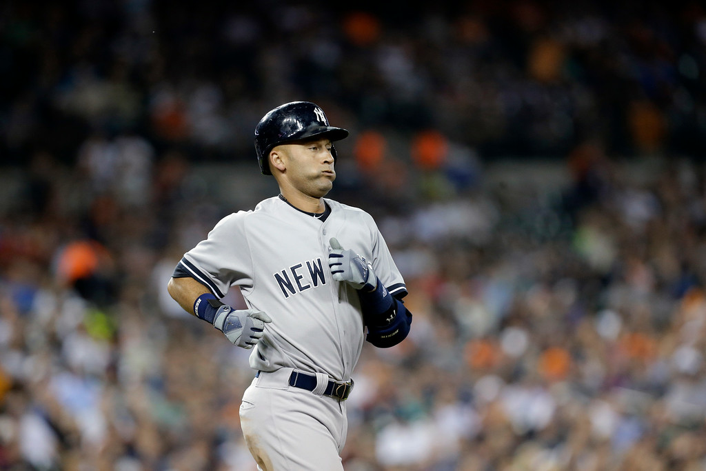 . New York Yankees\' Derek Jeter ground out against the Detroit Tigers in the fifth inning of a baseball game in Detroit Tuesday, Aug. 26, 2014. (AP Photo/Paul Sancya)