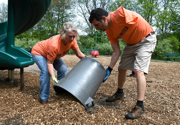 5/18/2018 Mike Orazzi | Staff United Way of Day Caring volunteers Jackie Merchant and Michael Ganem while working in Lake Winfield in Plymouth Friday.