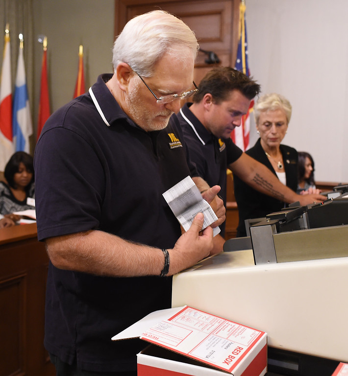 . Placing ballots in machine to count votes during Pasadena election that decided Terry Tornek will be the next mayor and Tyrone Hampton had a lead of Calvin Wells for City Council District 1 seat. (Photo by Walt Mancini/Pasadena Star-News)