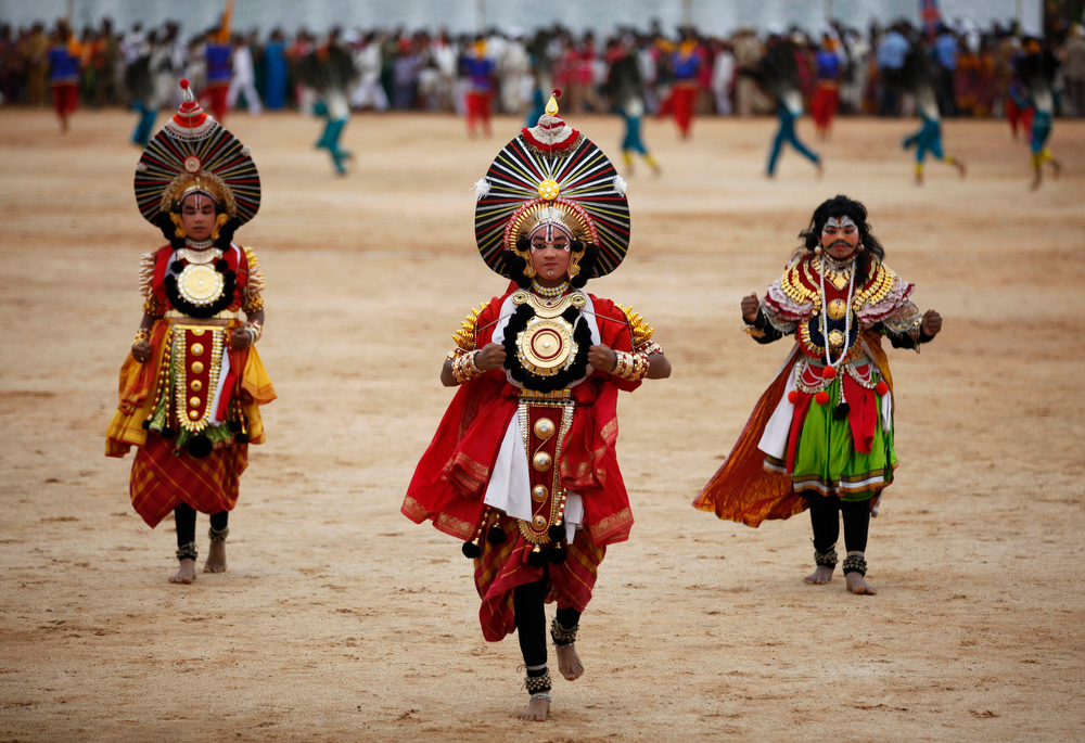 . Indian school children dressed in traditional attire perform during a function to mark India\'s Independence Day in Bangalore, India, Thursday, Aug. 15, 2013. (AP Photo/Aijaz Rahi)