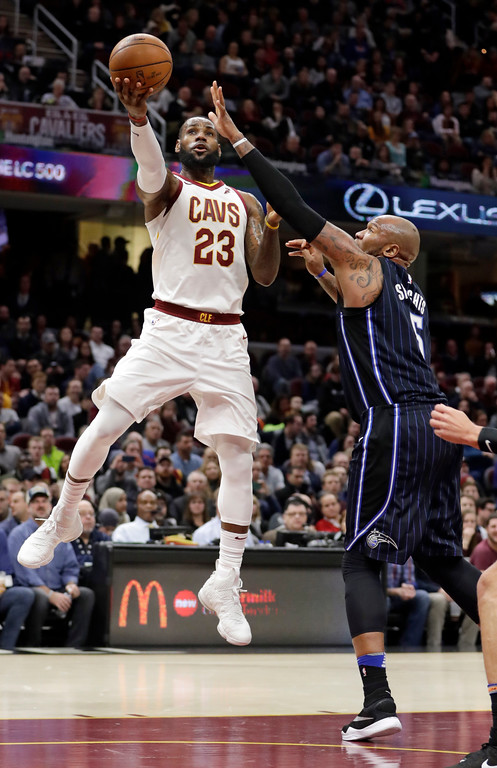 . Cleveland Cavaliers\' LeBron James shoots over Orlando Magic\'s Marreese Speights during the first half of an NBA basketball game Thursday, Jan. 18, 2018, in Cleveland. (AP Photo/Tony Dejak)