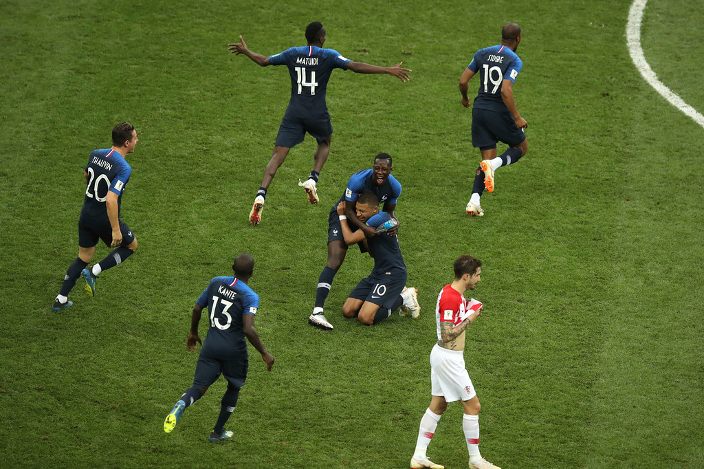 . Croatia\'s Sime Vrsaljko, foreground, reacts as French players celebrate at the end of the final match between France and Croatia at the 2018 soccer World Cup in the Luzhniki Stadium in Moscow, Russia, Sunday, July 15, 2018. (AP Photo/Thanassis Stavrakis)