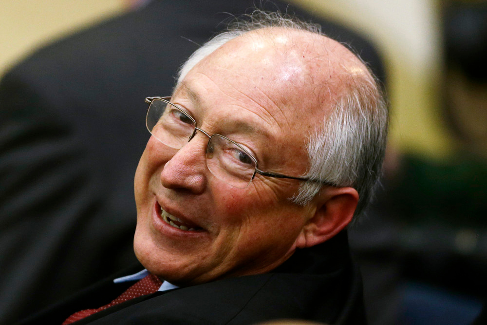Description of . Interior Secretary Ken Salazar, who earlier announced that he would be leaving the Cabinet in March, smiles in the South Court Auditorium at the White House in Washington, Wednesday, Jan. 16, 2013, before President Barack Obama spoke about proposals to reduce gun violence. (AP Photo/Charles Dharapak)