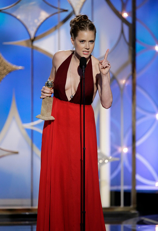 """. This image released by NBC shows Amy Adams accepting the award for best actress in a motion picture, musical or comedy for her role in, \""""American Hustle\""""  during the 71st annual Golden Globe Awards at the Beverly Hilton Hotel on Sunday, Jan. 12, 2014, in Beverly Hills, Calif. (AP Photo/NBC, Paul Drinkwater)"""