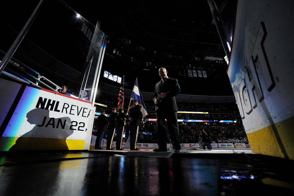 . Jake Schroeder walks off he ice after singing the national anthem during the game between the Colorado Avalanche and New Jersey Devils January 16, 2014 at Pepsi Center. (Photo by John Leyba/The Denver Post)