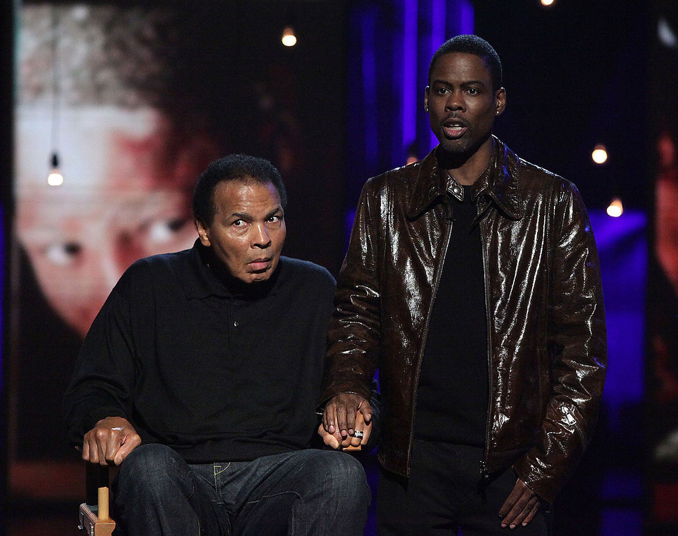 . In this handout photo provided by MTV, Boxer Muhammad Ali and comedian Chris Rock perform during the Hope For Haiti Now: A Global Benefit For Earthquake Relief at CBS Television City January 22, 2010 in Los Angeles, Californa.  (Photo by Handout/MTV Hope for Haiti Now via Getty Images)