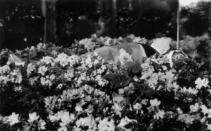 """. Dressed in a black western suit, the dead body of North Korean President Kim Il Sung lies in a flower-bedecked open coffin at his presidential palace in Pyongyang, North Korea, on July 11, 1994. The late Kim died of a heart attack on July 08, after his death, Kim Il-sung is named \""""eternal president\"""" of Democratic People\'s Republic of Korea.        (AFP/Getty Images)"""