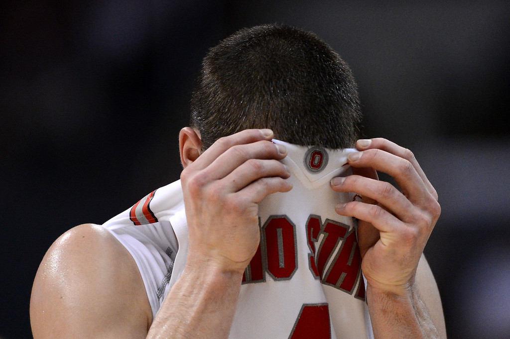 . Aaron Craft #4 of the Ohio State Buckeyes reacts in the first half while taking on the Wichita State Shockers during the West Regional Final of the 2013 NCAA Men\'s Basketball Tournament at Staples Center on March 30, 2013 in Los Angeles, California.  (Photo by Harry How/Getty Images)
