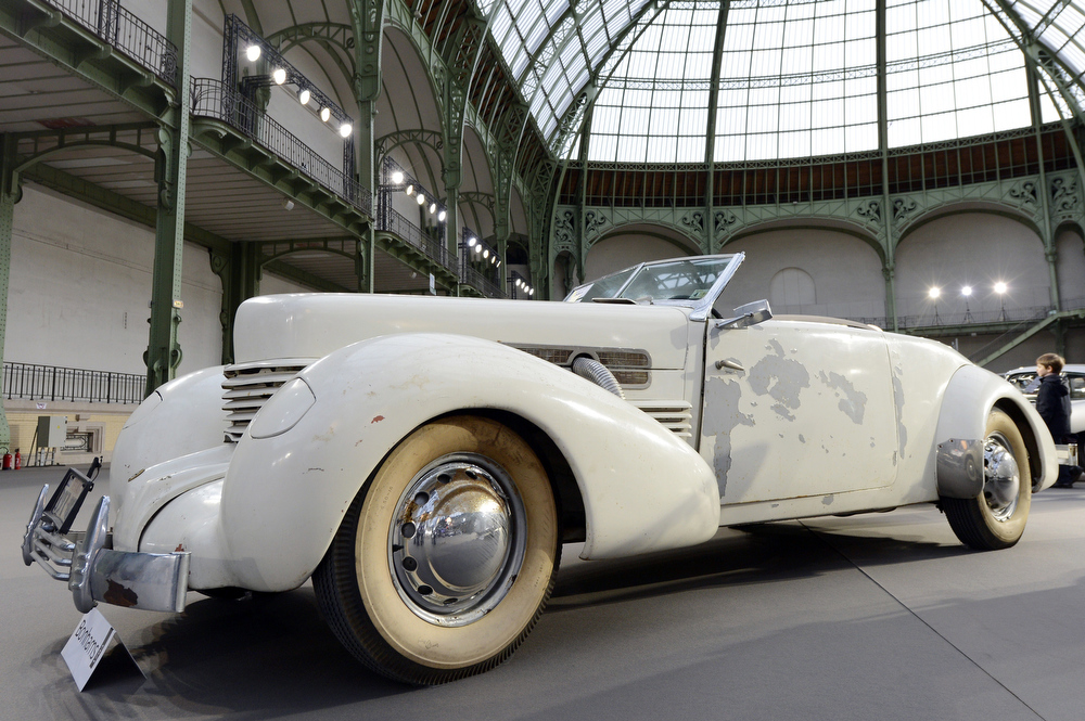 . A Cord 812 « Compresseur » Phateon (1937) is pictured as luxury vintages cars are displayed at an auction at the Grand Palais on February 6, 2013 in Paris. 125 vintage motor cars, 100 collection motorbikes and a 1920\'s Gipsy Moth plane by De Havilland, will be presented at the Bonhams auction on February 7.  BERTRAND GUAY/AFP/Getty Images