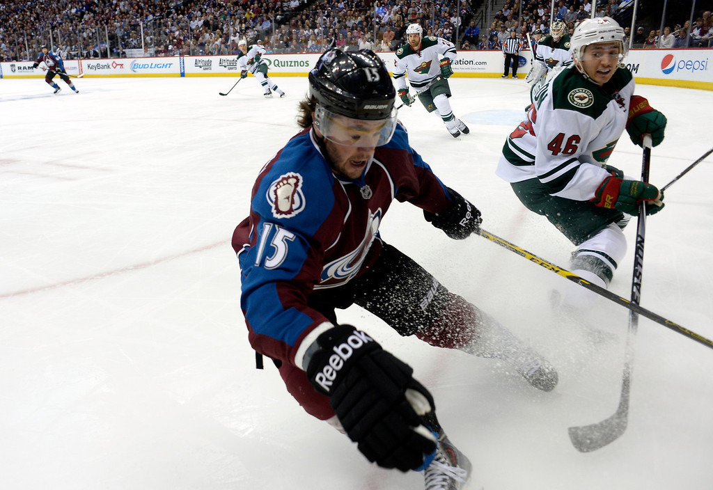 . DENVER, CO - APRIL 26: Colorado Avalanche right wing P.A. Parenteau (15) goes for the puck in the corner with Minnesota Wild defenseman Jared Spurgeon (46) during the first period of action. The Colorado Avalanche hosted the Minnesota Wild in the fifth round of the Stanley Cup Playoffs at the Pepsi Center in Denver, Colorado on Saturday, April 26, 2014. (Photo by John Leyba/The Denver Post)