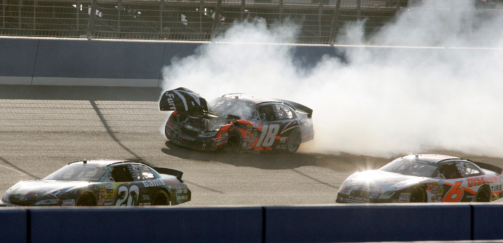 . Leading with just a few laps to go in the race, Kyle Busch in his Z-Line Designs Toyota crashes into the wall in Turn Four, narrowly avoiding other cars, in the NASCAR Copart 300 auto race in Fontana, Calif., Saturday, Oct. 10, 2009.  (AP Photo/Reed Saxon)