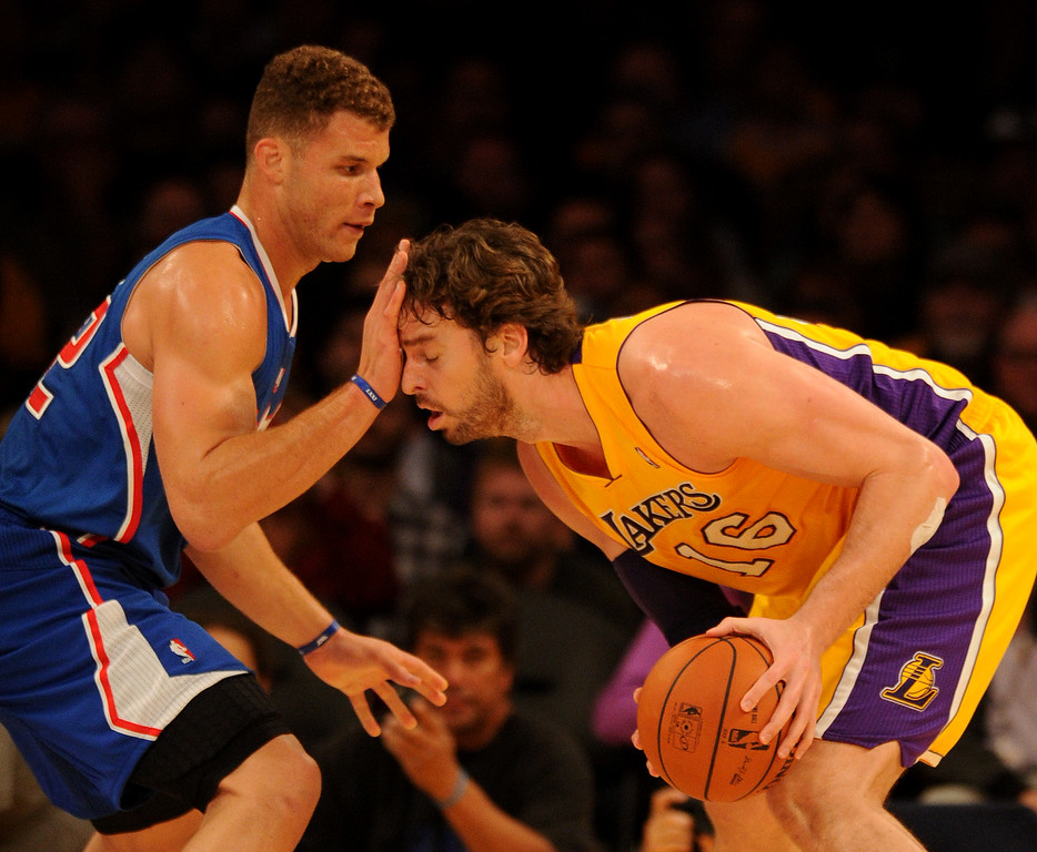 """. \""""Clippers#32 Blake Griffin fouls Lakers#16 Pau Gasol in the first quarter. The Los Angeles Lakers played the Los Angeles Clippers in the opening game of the season at Staples Center. Los Angeles, CA. 10/29/2013. photo by (John McCoy/Los Angeles Daily News)"""