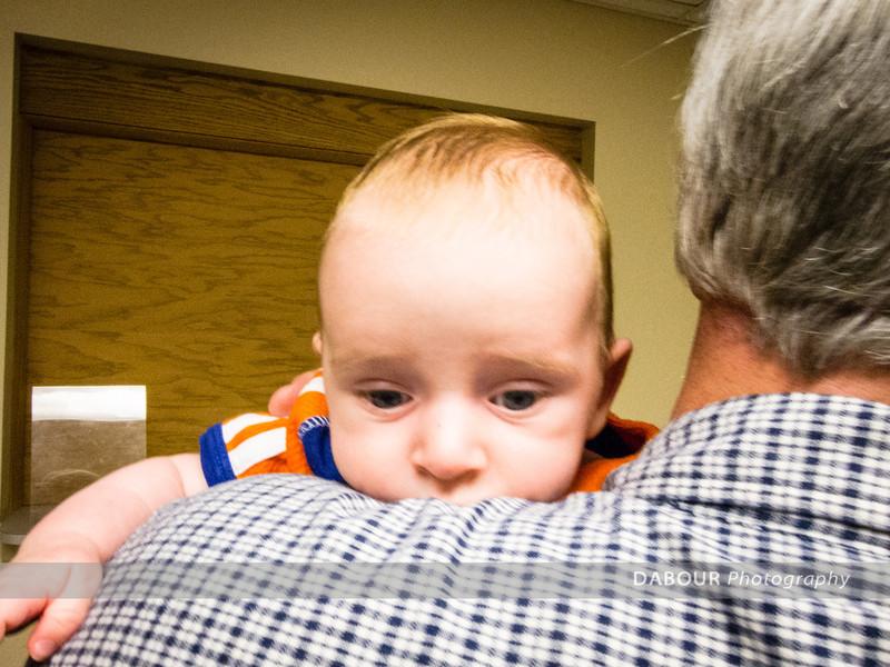 Jeff & Jane Anderson's new grandson on the shoulder of John Rivers