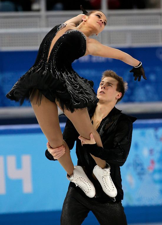 . Elena Ilinykh and Nikita Katsalapov of Russia compete in the team free ice dance figure skating competition at the Iceberg Skating Palace during the 2014 Winter Olympics, Sunday, Feb. 9, 2014, in Sochi, Russia. (AP Photo/Bernat Armangue)