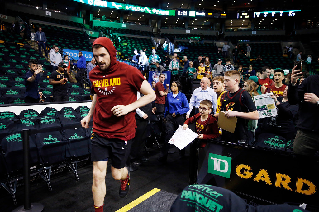 . Fans watch Cleveland Cavaliers center Kevin Love take the floor to warm up before Game 1 of the NBA basketball Eastern Conference Finals, Sunday, May 13, 2018, in Boston. (AP Photo/Michael Dwyer)