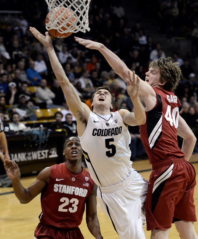 . University of Colorado\'s Eli Stalzer gets his shot blocked by John Gage, No. 40, during a game against Stanford on Thursday, Jan. 24, at the Coors Event Center on the CU campus in Boulder. Jeremy Papasso/ Camera