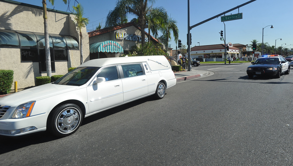 . The hearse carrying the body of Mario Jimenez drives past his restaurant Mario\'s Tacos after the funeral service at St. Hillary\'s Catholic Church in Pico Rivera on Tuesday October 15, 2013. Jimenez who had been an active member of the community and hosted their free Thanksgiving dinners, died Wednesday October 8th after a long battle with cancer. (Whittier Daily News/Staff Photo by Keith Durflinger)