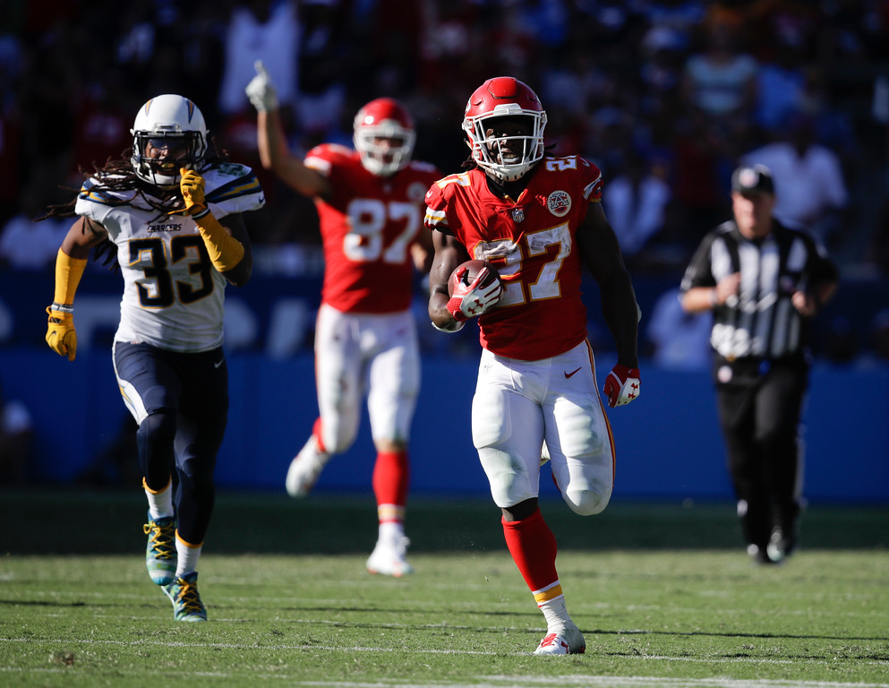 . Kansas City Chiefs running back Kareem Hunt, right, scores against the Los Angeles Chargers during the second half of an NFL football game Sunday, Sept. 24, 2017, in Carson, Calif. (AP Photo/Jae C. Hong)