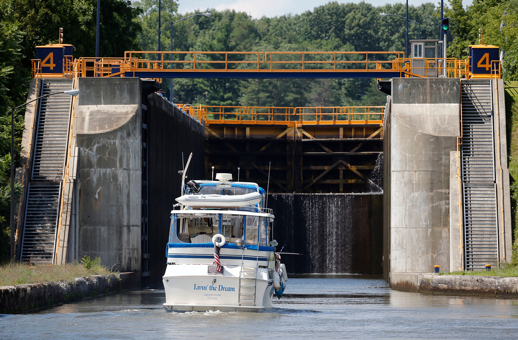 . In this Tuesday, Aug. 4, 2015 photo, a boat enters Lock 4 of the Erie Canal in Waterford, N.Y. The Erie Canal was an engineering marvel when it opened in 1825, linking the Hudson River to the Great Lakes and humming with activity that opened up the West. Now a renewed court fight has drawn fresh attention to the 360-mile-long ribbon of channels, lifts and locks between Albany and Buffalo, calling into question whether taxpayers will again have to foot the hefty bill to keep it and the other canals in the system operating.  (AP Photo/Mike Groll)