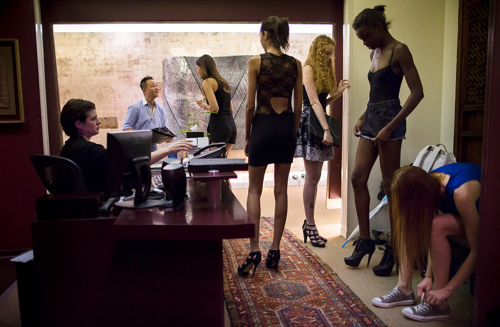 . Models wait to be seen by Il Park, second from left, creative director for fashion designer Carmen Marc Valvo, during casting for an upcoming show at Valvo\'s studio in New York. Valvo will show his Spring 2014 collection on Sept. 6 at Lincoln Center in New York. (AP Photo/John Minchillo)