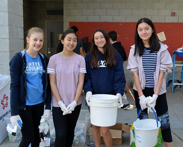 Families Pitch In for LCHS Campus Cleanup