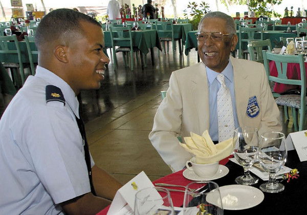 15 MSS Commander Major Christopher Herring, left, visits with Captain Shoecraft before the Black History Month Luncheon.