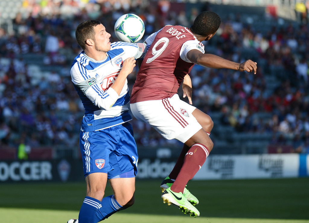 . COMMERCE CITY, CO. - June 01: Edson Buddle of Colorado Rapids (9) and Matt Hedges of FC Dallas (24) are fighting for the control of the ball during first half of the game at Dick\'s Sporting Goods Park. Commerce City, Colorado. June 1, 2013. (Photo By Hyoung Chang/The Denver Post)