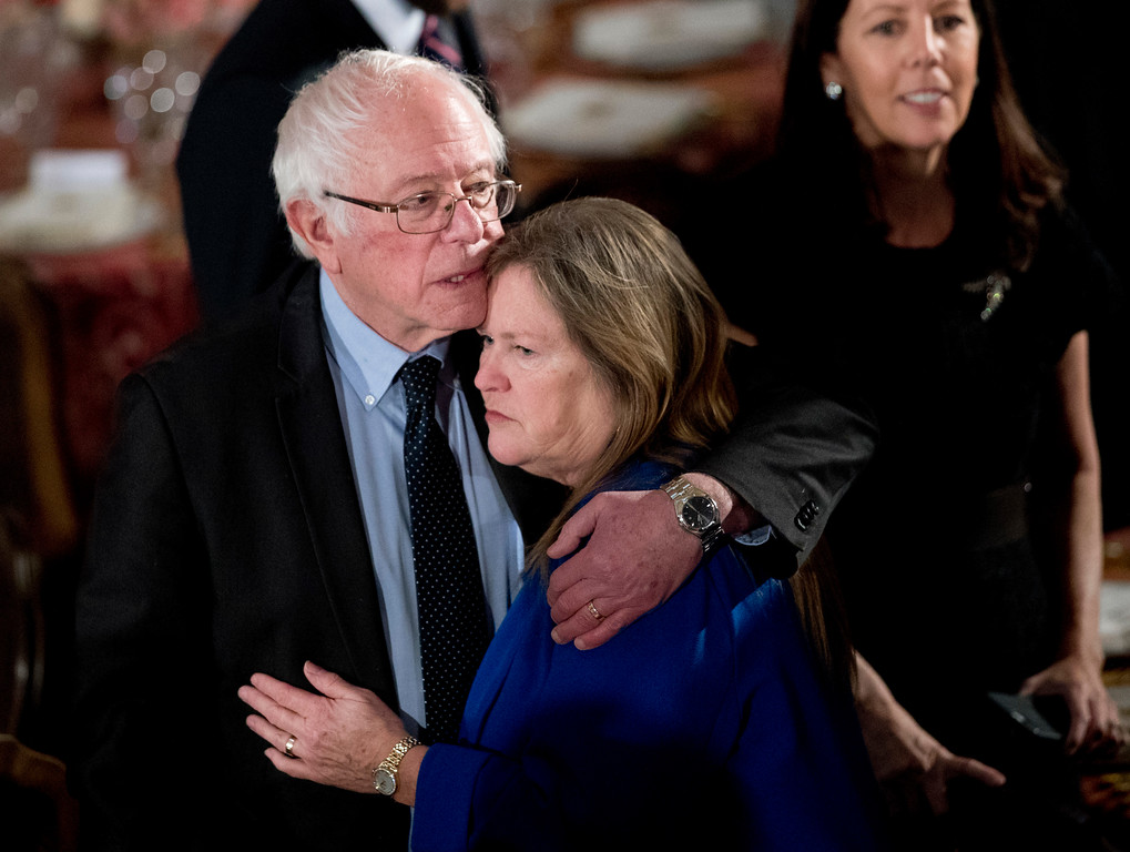 . Sen. Bernie Sanders, I-Vt., hugs his wife Jane O\'Meara Sanders, during the inaugural luncheon in honor of President Donald Trump at the Statuary Hall in the Capitol, Friday, Jan. 20, 2017, in Washington. (AP Photo/Manuel Balce Ceneta)