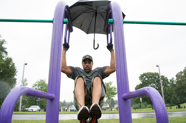 08/28/19 Wesley Bunnell | Staff Ray Robinson of New Britain doesn't let the rain stop his workout at Walnut Hill Park on Wednesday August 28, 2019. Robinson works out at the park regardless of the weather several times a week.