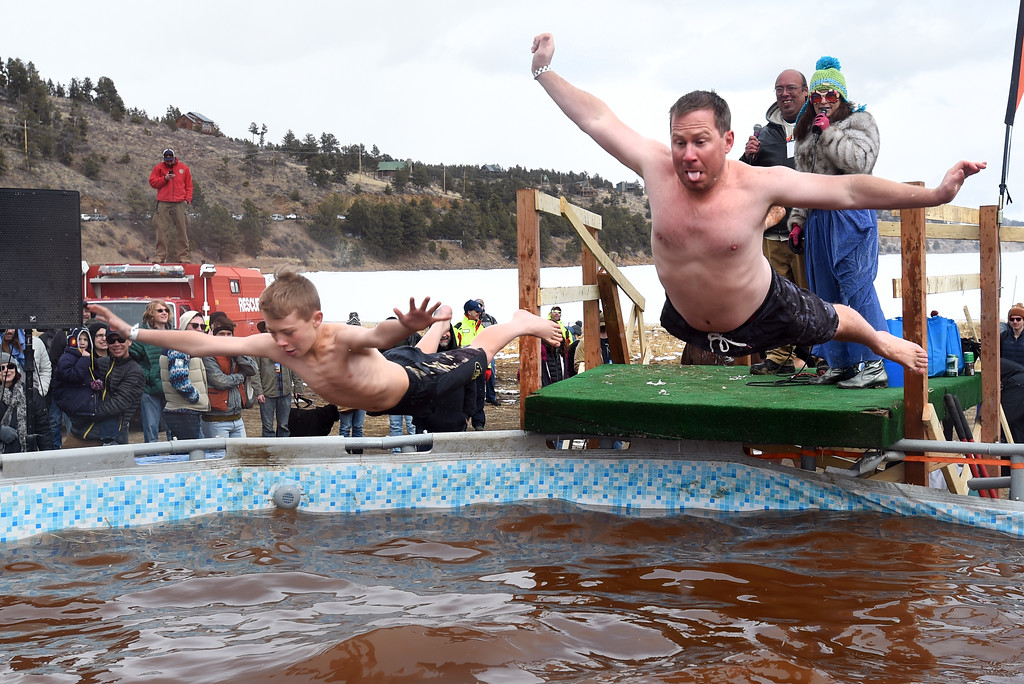 . A father and son dive on Saturday during 2018 Frozen Dead Guy Days in Nederland. The festival continues on Sunday. For more photos, go to dailycamera.com. Cliff Grassmick  Photographer  March 10, 2018