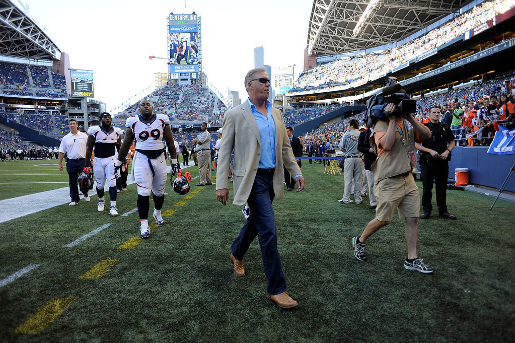 . SEATTLE, WA. - AUGUST 17: Denver Broncos Executive V.P. of football operations walks off the field after the teams warmups before their game against the Seattle Seahawks August 17, 2013 at Century Link Field. (Photo By John Leyba/The Denver Post)