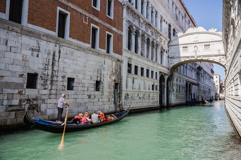 Gondola going under the Bridge of Sighs in Italy