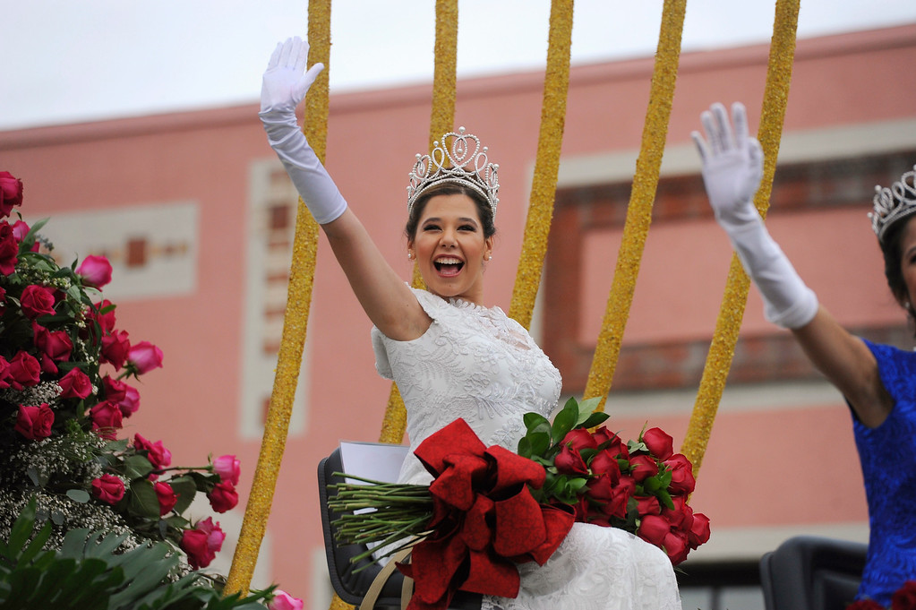 . Rose Queen Victoria Castellanos, of Temple City High School, waves to the crowd at the 128th Rose Parade in Pasadena, Calif., Monday, Jan. 2, 2017. The 5½-mile parade featured marching bands, horseback riders and dozens of ornately decorated flower-covered floats. (AP Photo/Michael Owen Baker)
