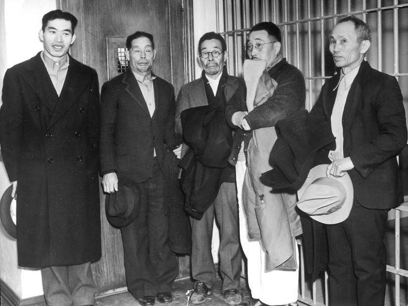 """""""These Japanese were held at the Firestone Sheriff's substation during the blackout.  They are, left to right, Sukechi Yokoyama, Tokushici Okuda, Ryosuke Yamado, Setsuji Fugimoto and Seiichi Ishii.  All were freed.""""--caption on photograph"""