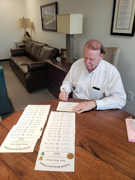 Mr. Perry Signing Diplomas