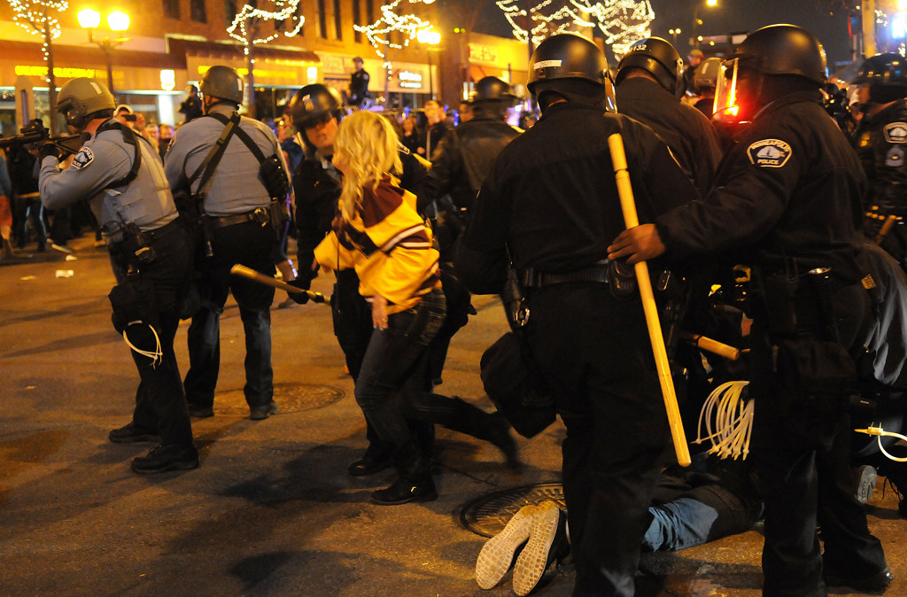 . Fans are arrested by Minneapolis police as they disperse the crowd gathered in an intersection in Dinkytown after the loss to Union during the Frozen Four Championship. (Pioneer Press: sherri LaRose-Chiglo)