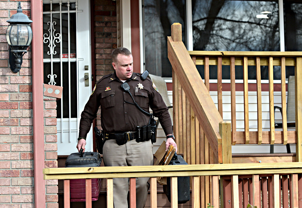 . David Porter, with Weld County Sheriff\'s Office, executes a search warrant at 174 Mt. Massive Way in Longmont on Tuesday, Dec. 18, 2012. (Greg Lindstrom/Times-Call)