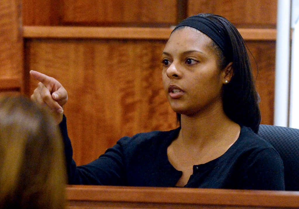 . Shaneah Jenkins, who was dating Odin Lloyd, points to former New England Patriots football player Aaron Hernandez when asked by a prosecutor to identify him in the courtroom during Hernandez\'s murder trial, Friday, Jan. 30, 2015, in Fall River, Mass. Hernandez is charged with killing semiprofessional football player Odin Lloyd, 27, in June 2013. (AP Photo/The Boston Herald, Ted Fitzgerald, Pool)