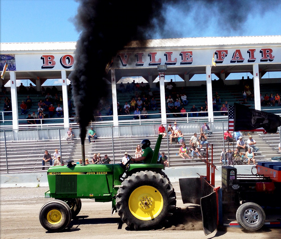 . Jim Lewis competes in the tractor pull competition at the Boonville Oneida County Fair on Thursday, July 24, 2014 in Boonville. The fair runs through Sunday, July 27, 2014. JOHN HAEGER-ONEIDA DAILY DISPATCH @ONEIDAPHOTO ON TWITTER