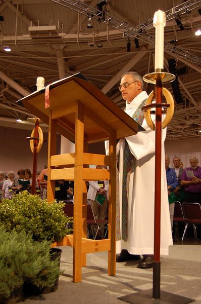 The Rev. Rafael Malpica-Padilla, executive director, ELCA Global Mission Unit, reads Luke 9:1-6, the gospel lesson for Wednesday's worship service.