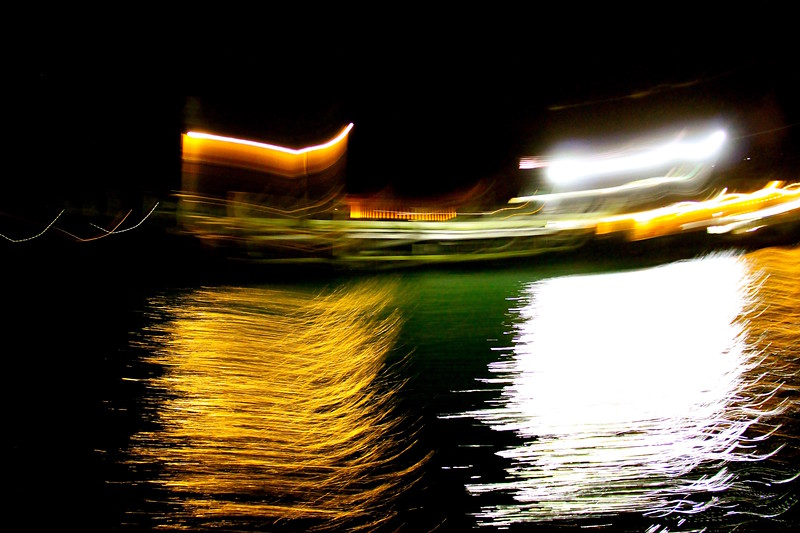 Boats reflections on water at night.jpg