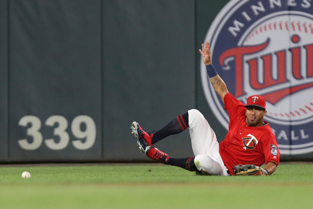 . Minnesota Twins\' Eddie Rosario slides toward a fly ball against the Cleveland Indians in the eighth inning of a baseball game Monday, July 30, 2018 in Minneapolis. Minnesota won 5-4. (AP Photo/Stacy Bengs)