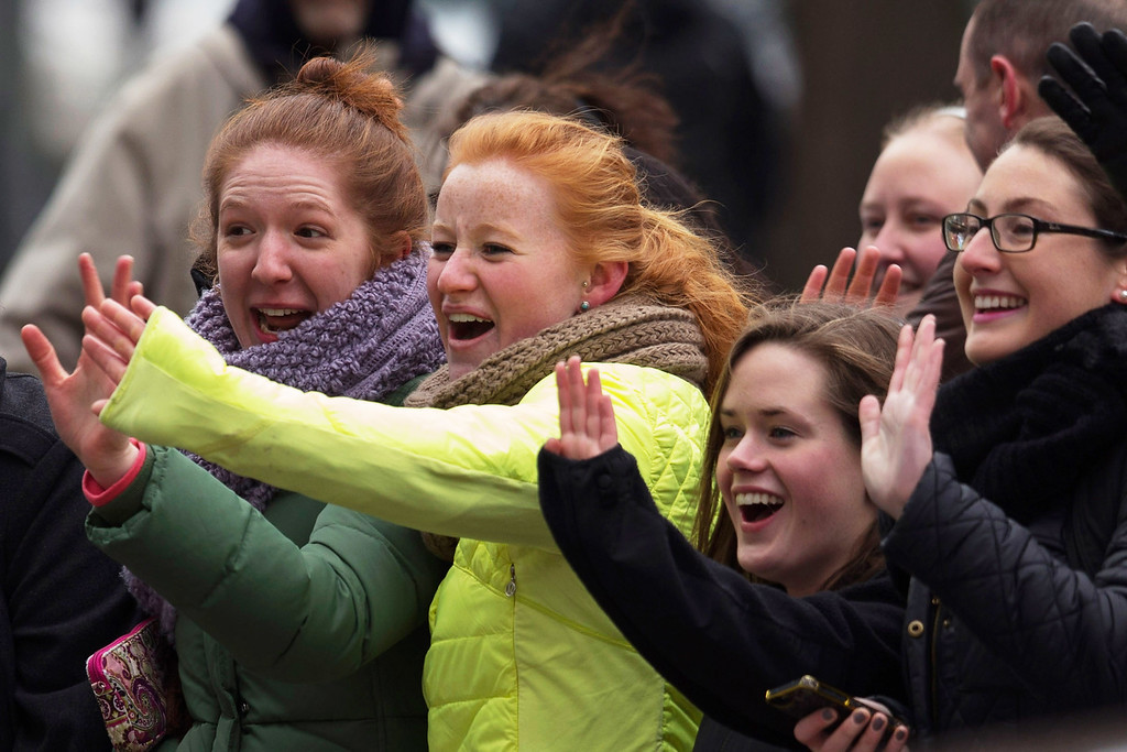 ". Young women cheer and wave as Prince William, Duke of Cambridge, leaves the World Bank headquarters after addressing the International Corruption Hunters Alliance Conference during an official three-day visit to the United States December 8, 2014 in Washington, DC. After meeting with U.S.  President Barack Obama earlier in the day, the Prince William addressed the conference, calling the trade in elephants tusks, rhino horns and other animal parts as one of the most insidious forms of corruption and criminality in the world today.""   (Photo by Chip Somodevilla/Getty Images)"